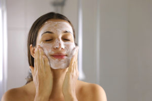 Beauty salon in Maidenhead - Skincare Woman Washing Face Foaming Facewash Soap Scrub On Skin